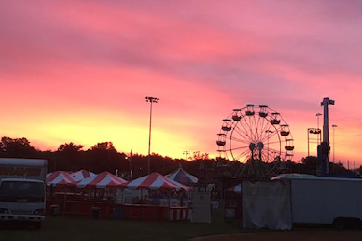 Sunrise Over the Carnival - by Bob C.